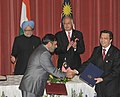 Anand Sharma and the Malaysian Minister of Health, Mr. Y.B. Dato' Sri Liow Tiong Lal exchanging the signed documents of an MoU in the field of Traditional Systems of Medicine, between India and Malaysia.jpg