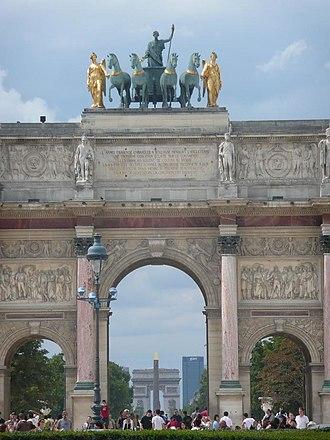 Axe historique - The Arc de Triomphe du Carrousel, the obelisk of the Place de la Concorde, the Arc de Triomphe de l'Étoile, and the Grande Arche of La Défense, on the same perspective.