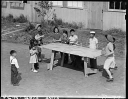 Arcadia, California. A ping pong game on a home-made table occupies the attention of these young ev . . . - NARA - 537449