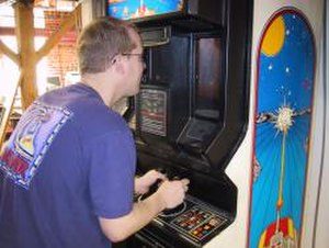 """Battlezone (1980 video game) - The cabinet of this arcade version of Battlezone has a """"periscope"""" and two joysticks, for controlling the movement of the player's tank."""