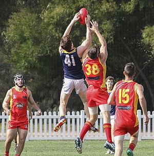 Glossary of Australian rules football - Player gains possession in a marking contest