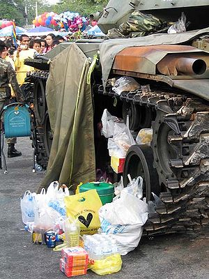 2006 Thai coup d'état - Food given by supporters of the coup stacking up near an armoured vehicle.