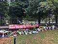 Banner and flowers at Rolleston Ave memorial for Christchurch mosque shootings, day after event, 16 March 2019.jpg