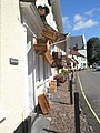Baskets outside gift shop in Dunster - geograph.org.uk - 925138.jpg
