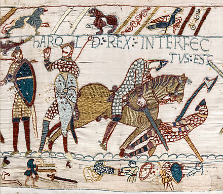 "Harold's death depicted in the Bayeux Tapestry, reflecting the tradition that Harold was killed by an arrow in the eye. The annotation above states Harold Rex interfectus est, ""Harold the King has been killed"". Bayeux Tapestry scene57 Harold death.jpg"