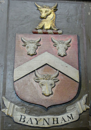 Clearwell - Arms of Baynham: Gules, a chevron argent between three bull's heads cabossed argent armed or. Crest: A bull's head erased or. Painted escutcheon on the 19th-century mural monument erected in Mitcheldean Church, Gloucestershire