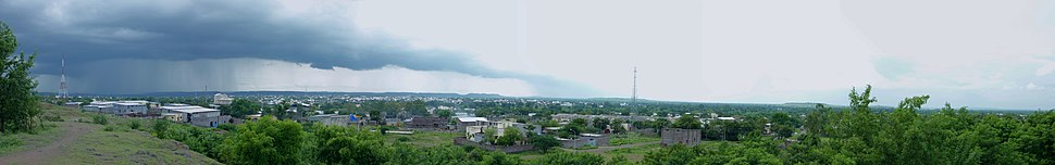 Panoramic view of a part of Beed city from the eastern hills on a rainy day. Eastern hills in the city and western hill range are visible in the view