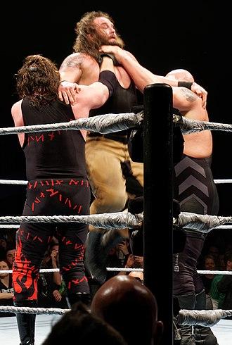 Chokeslam - Big Show and Kane performing double chokeslam on Braun Strowman