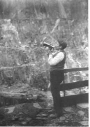 The signal for blasting is blown at the Penrhyn Quarry c.1913.