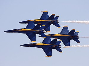 Blue Angels - The Blue Angels F/A-18 Hornets fly in a tight diamond formation, maintaining 18-inch wing tip to canopy separation.