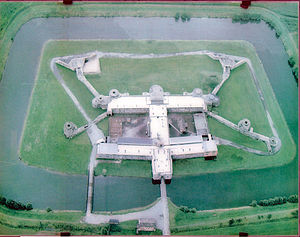 Fort Breendonk - Modern aerial photograph of Fort Breendonk, from the north. The earth which originally covered the Fort's structure was removed by the prisoners under German supervision