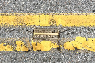 Bristol, Virginia - Double yellow line on State Street, separating Virginia from Tennessee with a bronze marker embedded in pavement.