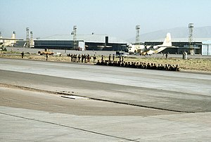 55th Airborne Brigade - Paratroopers wait at Shiraz Air Base to board a Lockheed C-130 Hercules aircraftfor a training mission during Exercise CENTO on 1 August 1977
