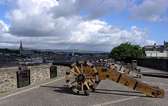 County Londonderry - A cannon sits atop the historic Derry Walls, which look over Derry City.