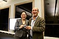 Carl Malamud of Resource.org Presenting a Chicago City Clerk Susan Mendoza a Rubber Stamp with a Quote for Justice Stephen Breyer at the OpenGovChicago Meetup at the Chicago Cultural Center (10891693646).jpg