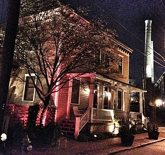 Cabbagetown, Atlanta - Carroll Street at night, with smokestack of Fulton Bag and Cotton Mill in background
