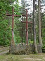 Catholic and Orthodox crosses in forest - panoramio.jpg