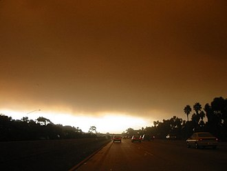 Cedar Fire (2003) - View of the Cedar Fire from southbound Interstate 5 near Pacific Beach, on the first morning of the fire