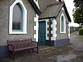 Chapel entrance and memorial bench - geograph.org.uk - 1732730.jpg