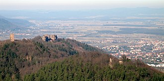 "Battle of Strasbourg - View of Saverne (town on right) from a foothill of the Vosges mountains. The hill contains the ruins of fortifications from various eras, including the medieval Chateau de Geroldseck (right). The town, known as Tres Tabernae (""Three Inns"") to the Romans, lay astride the main Roman highway through the Vosges from Alsace into Gaul. Strasbourg lies some 30km off the right edge of the picture"