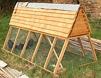 A movable chicken coop with an A-frame design ...