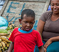 Child and his mother by selling bananas.jpg