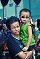 Chinese Indonesian man and boy, cap go meh 2010.jpg