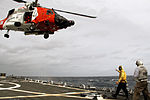 Coast Guard refuels aboard Navy ship during rescue mission 140114-G-ZZ999-002.jpg