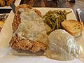 Country Fried Ribeye served with mashed potatoes and white gravy with smothered green beans.jpg