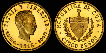 The Coat of arms of Cuba depicted on the obverse of a 1915 gold 5 Cuban peso coin.