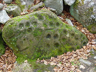 Clava cairn - Cup marks on the northern cairn at Balnuaran of Clava