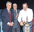 D.V. Sadananda Gowda lighting the lamp to inaugurate the Legal Services schemes of National Legal Services Authority (NALSA) and a workshop on Actualisation.jpg