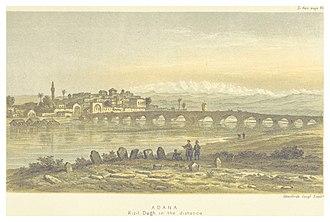 Taşköprü (Adana) - Taşköprü, with Adana and the Kizildag mountains, from a view by Edwin John Davis published in Life in Asiatic Turkey in 1879.