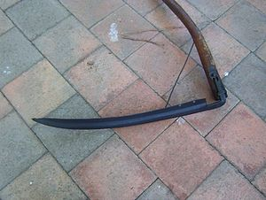 Scythe - The under-side of the blade normally facing the ground, note that it is convex across it width while the top side is concave or cupped.