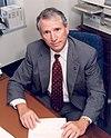 Daniel R. Mulville, at desk