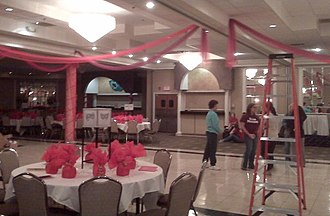 Prom - Decorating for prom, students and student advisers put finishing touches on a ballroom at a banquet hall.