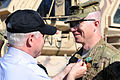 Defense.gov News Photo 110308-D-XH843-009 - Secretary of Defense Robert M. Gates presents the Purple Heart and the Army Commendation Medal with Valor to Army Capt. Jeffrey Mackinnon 1st.jpg
