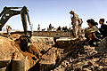 Defense.gov News Photo 110328-M-SB982-051 - U.S. Marine Corps 1st Lt. Daniel Hough and Afghans watch as Marines remove a bridge and culvert at Kakar village Helmand province Afghanistan on.jpg