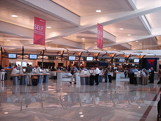Hartsfield–Jackson Atlanta International Airport - A line of automated and staffed ticketing counters for Delta, Atlanta's major tenant airline.