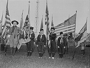 Cub Scouting (Boy Scouts of America) - Detroit, Michigan. Cub Scouts with flag standards at the British Blitz Scout meeting, 1942