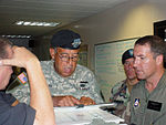Dick Gremillion, Army Lt. Gen. Russel L. Honoré and Civil Air Patrol Col. Rock Palermo discuss hurricane relief efforts at the operations center in Lake Charles, La.JPG