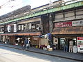 Dingy, falling down places under the tracks are the very definition of Tokyo traditional (3194760940).jpg