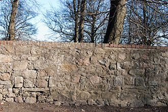 Bishop Dunbar's Hospital - The location of two windows in the wall of Seaton Park, adjacent to the Cathedral Church of St Machar, Old Aberdeen. These window cills are the only remains of the 1531 Hospital.