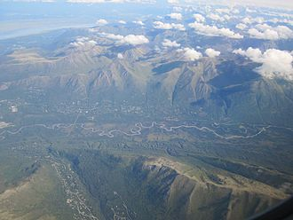 Eagle River, Anchorage - Upper Eagle River valley, with Hiland Road neighborhoods in the left foreground and the Chugach Mountains in the background.