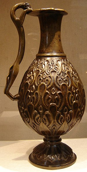 Islamization of Iran - Early Islamic era Iranian art: Ewer from 7th century Persia. Cast, chased, and inlaid bronze. New York Metropolitan Museum of Art.