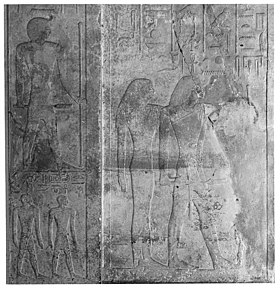 Relief with a man and a woman standing, surrounded by hieroglyphs