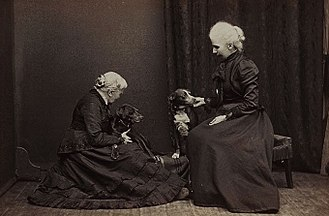 Elizabeth Blackwell - Elizabeth Blackwell, 1905. Courtesy of Blackwell Family Papers, Schlesinger Library. Photograph of an older Elizabeth Blackwell with her adopted daughter Kitty and two dogs, 1905.