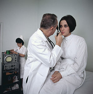 A doctor examines a female patient.