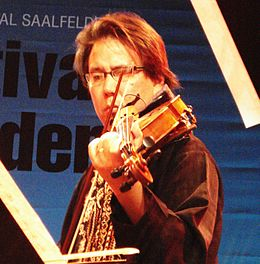 Eyvind Kang live with Rova: Orchestrova's Electric Ascension in Saalfelden, 2009. (Photo by Davide Leonardi)