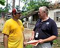 FEMA - 35507 - Community Relations specialist speaking to resident.jpg